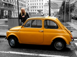 The Lion with a yellow Fiat 500